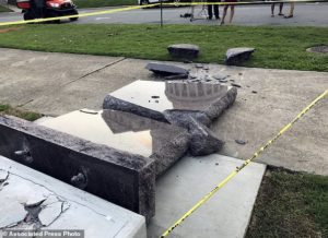 The new Ten Commandments monument outside the state Capitol in Little Rock, Ark., is blocked off Wednesday morning, June 28, 2017, after someone crashed into it with a vehicle, less than 24 hours after the privately funded monument was installed on the Capitol grounds. Authorities arrested a male suspect. (AP Photo/Jill Zeman Bleed)